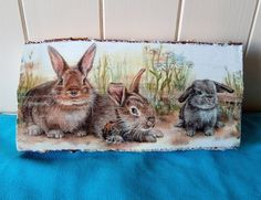Decoupaged log with a rabbits design. Rabbits, Decoupage, Boxes, Animals, Design, Crates, Animales, Animaux, Bunnies