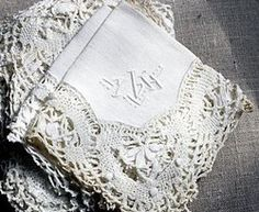 `Beautiful cluny lace trimmed napkins.