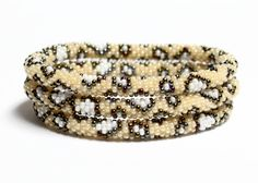 Amazing leopard print beadwork Nepal Roll On bracelets! Each bracelet is strung one seed bead at a time by Lotus Sky's all-woman team in Kathmandu, Nepal before it ends up on your wrist! Global Sisterhood XOXO!