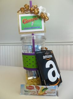 "Gift for Teachers: ""Cheers to the end of a GREAT school year!""      An insulated cup, individual serving drink mixes and book store gift card.    Inside card reads:  ""Summer's here!  Treat yourself to a COLD drink and a GOOD BOOK!"""