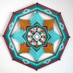 Ojos De Dios. My mother made these in the late 70's. I remember seeing them in Navajo homes. Very Nostalgic.