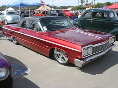 Chevrolet Impala 64 <3... A friend of mine in High school that I worked with in the Youth Tutoring Youth program drove one of these..I was so jealous lol
