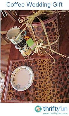 Do away with the wrapping paper for a more eco-friendly present.  I used 4 bamboo placemats to wrap the coffee and tea containers.  I was able to find 4 cups in a metal holder that I wrapped with 4 more bamboo placemats.  The paper plate is for the bottom so the things don't fall through.  By wrapping raffia underneath and over and then around the center, you  have a great handle and nice gift.