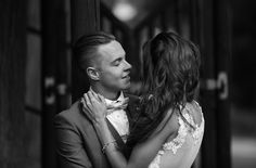 Bride & groom romantically look into each others eyes. Bride & groom getting married outside in traditional style at Theobald's Park Hotel North London.
