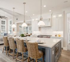 White kitchen white grey island and rattan island chairs/stools