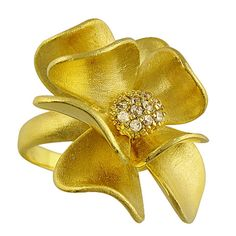14 k Gold Dipped Floral Ring with Cubic Zirconia stones set in the center. Great Gold and Bold Statement Ring for your index or middle