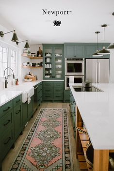 This stunning alternative to marble countertops pairs beautifully with green kitchen cabinets in this farmhouse kitchen. Newport is a white quartz countertop that is maintenance free, durable, and stain resistant. The green cabinetry in this kitchen desig Farmhouse Kitchen Decor, Home Decor Kitchen, Kitchen Interior, New Kitchen, Kitchen Ideas, Luxury Kitchen Design, Luxury Kitchens, Cool Kitchens, Sage Green Kitchen