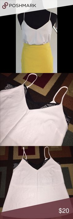 Camisole White camisole with sheer partial black lace inset. Polyester. Worn once and in like-new condition. *Inner care tag has been removed* Zara Tops