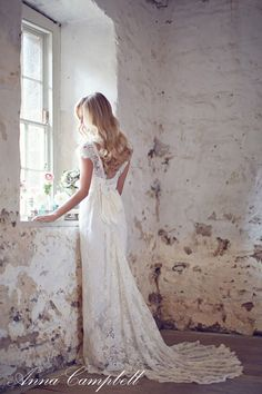 Lost in a dream. Beautiful lace wedding dress.
