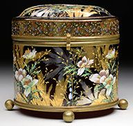 Moser Decorated Box Has Cylindrical Body And Domed Top All Decorated With Brightly Enameled Flowers Against A Background Of Gold And Platinum Gilded Foliage, Domed Lid Has Gilded Band With Sprays Of Tiny Brightly Colored Flowers Surrounding The Edge, Finished With Brass Collar Hinge And Clasp As Well As Brass-Bottom Band With Four Ball Feet  -  James D. Julia, Inc. Auctioneers