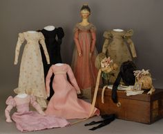 Early 19th century doll with a trunk and wardrobe, including bonnets.  Wow!