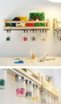 A small wooden shelf with a magnetic knife rack attached to the underside holds jars filled with beads. A close-up image of a magnetic knife rack holding jars of beads under a small wooden shelf.