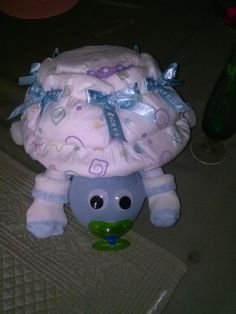 Turtle made from diapers, socks, other baby itemsMothers Day is approaching fast, do you have something for the new mom?  PUT THEM IN A FRESH FLOWER ARRANGEMENT! * GREAT FOR BALLOON WEIGHTS AT THE SHOWER! * ATTACH A GIFT CERTIFICATE TO THEM! * USE THEM AS CENTERPIECES AT YOUR NEXT BABY SHOWER! * BRING 'EM TO THE HOSPITAL WHEN MOM HAS THE NEW BABY! * DECORATE THE NURSERY! * USE YOUR IMAGINATON AND HAVE A BLAST WITH THEM! Come a look at my page, I have many other designs.  .