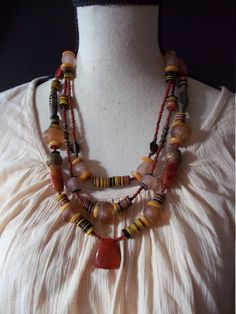 ARTISAN OOAK multi-strand necklace with African beads.  Carnelian, Agate central bead from Mali, bronze west african beads in russet autumn. by Timbuktugallery on Etsy