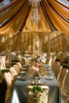 Dramatic Tent with chandeliers, candelabras and fabric dripping from the ceiling