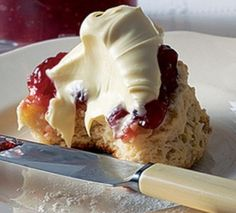 Scone with jam and clotted cream.