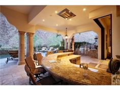 The outdoor poolside bar of a delightful home in La Quinta, CA