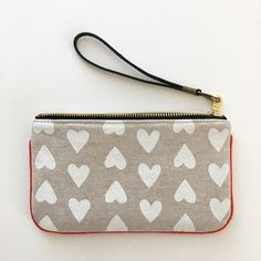 Happy Valentine's Day, friends !!!     I simply couldn't resist and had to whip up this sweet little wristlet using super adorable fabri...