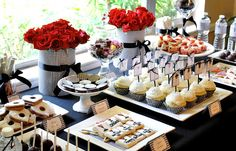 dessert bar with cupcakes, cookies, cake pops, choc pretzels and candy to go with red black and white