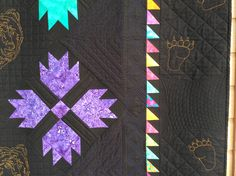 Bear Paw Quilt with bear tracks around the edge.