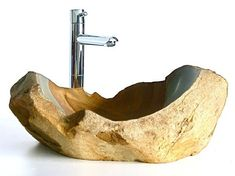 Natural stone sinks. Very handsome!  http://www.homedit.com/natural-stone-sinks-for-a-unique-bathroom-interior/