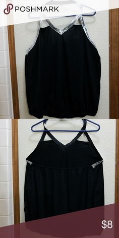 Halter Top With Sequins Black halter top with sequins. Elastic astound waist and across the back. Size 5X but fits more like 2X or 3X. Never worn. Tops