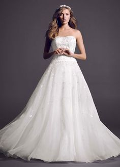 Strapless satin bodice with beaded embroidery, organza ball gown skirt, and chapel train.