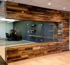 Recycled pallet and reclaimed wood paneling in office