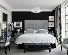 Black and White interior design bedroom - black wall and small art around it