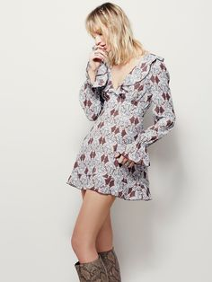 Smooth Operator Printed Tunic | Vintage-inspired tunic featuring ruffle…