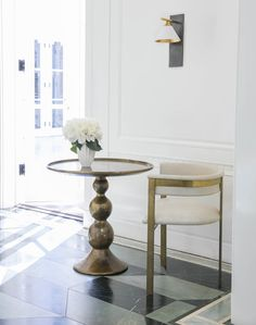 KELLY WEARSTLER   CLEO SCONCE. Sophisticated and geometric sconce in antique brass
