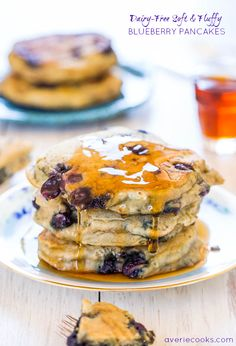 Dairy-Free Soft and Fluffy Blueberry Pancakes - Healthier pancakes that are soft, fluffy, light & just bursting with blueberries! Replaced egg with half a banana and used coconut sugar. BEST VEGAN PANCAKES EVER!!