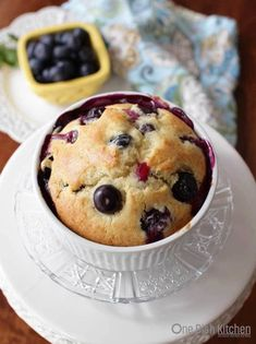 This big, bakery style Blueberry Muffin is loaded with plump, sweet blueberries and can be baked in a ramekin. It's got a tender texture and wonderful buttery flavor. If you love blueberries, you'll be glad to know that you're likely to find juicy blueberries in every single bite! | One Dish Kitchen | #blueberrymuffin #muffin #singleserving #recipeforone #cookingforone #dormcooking #blueberries #ramekin Best Blueberry Muffins, Blueberry Recipes, Blue Berry Muffins, Köstliche Desserts, Delicious Desserts, Muffin Recipes, Snack Recipes, Brunch Recipes, Bread Recipes