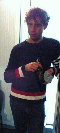 """Mika with a bottle - 2011 - from the """"Mika Backstage"""" album on Mika's Facebook page"""