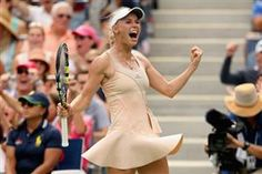 Caroline Wozniacki reached her first Grand Slam quarter-final since 2012 with a stunning win against fifth seed Maria Sharapova at the US Open on Sunday
