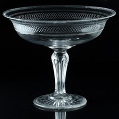 A striking footed bowl, the deep well upper section on a hollow tapered facet cut pedestal stem and thick conical...