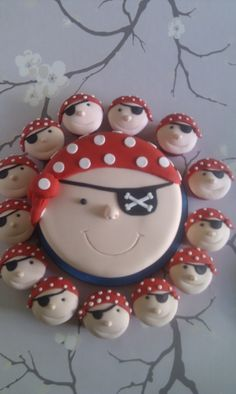 Pirate Cake and cupcakes I couldn't make this but ha ha what fun and if you had enough cupcakes you could keep the main cake for family tea with the nans
