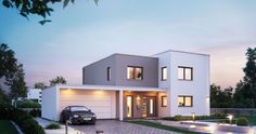 Massivhaus Kern-Haus Futura Bauhaus Eingangsseite am Abend