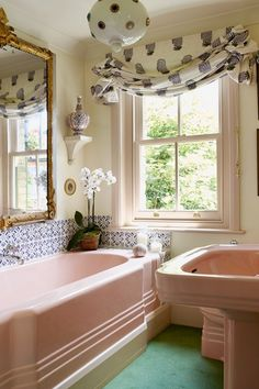 Discover the West London home of interior designer Louise Jones with the charm of an English country cottage on HOUSE - design, food and travel by House Garden - including the bathroom. Pink Tub, Pink Bathtub, Art Deco Bathroom, Bathroom Ideas, Bathroom Renovations, Bathroom Furniture, Bathroom Wall, English Country Cottages, Vintage Bathrooms
