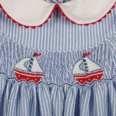 SMOCKED SAILBOATS DRESS WITH RED RICK RACK