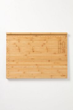 bamboo cutting board with ingredient measurement chart in upper irght hand corner