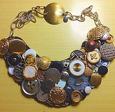 Recycled button necklace. Hand sewn to felt form with seed bead accents silver chain and gold clasp
