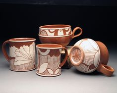 Terracotta sgrafitto mugs. I don't know that word, but I sure admire that artwork.