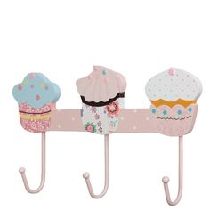 Cupcake coat hooks with a different scrumptious bakery treat above each hook. The pink colours make it a lovely addition to a girl's bedroom or cloak room.