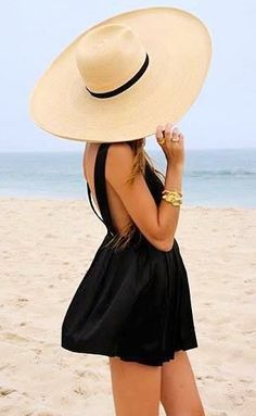 Invest in a cute sun hat for the beach. Fashionable meets sensible. It protects your scalp from burns, your hair from damage, and your face from wrinkles.