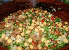FOUL MEDAMES - FAVA BEAN SALAD  2 cups of cooked fava beans 1 cup of cooked chickpes 3 lemons juiced 3 garlic cloves 1/2 cup of olive oil 1 tomato 1/2 cup of chopped parsley // comment area has directions ---- >