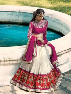 Cream and red georgette lehenga choli with resham embroidery work