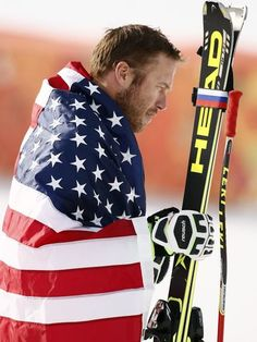 Bode Miller (USA) celebrates winning bronze in men's alpine skiing super-G during the Sochi 2014 Olympic Winter Games at Rosa Khutor Alpine