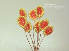 Free detailed tutorial with step by step photos on how to make French Marigolds out of seed beads and wire. Great for beginners!