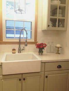 Corian linen counters light gray cabinets white subway for Corian farm sink price